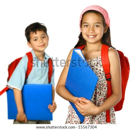 School children with blue folder and red rucksack, ready to attend school. - stock photo