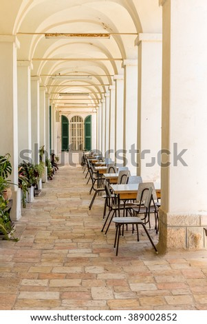 school class, tables and chairs outside in a monastery