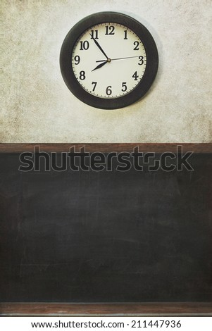School clock and blackboard with distressed wall - stock photo