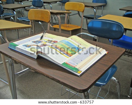 School Desk with Textbook - stock photo