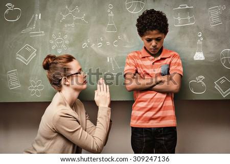 School doodles against teacher apologizing boy in classroom - stock photo