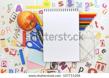School education background with blank exercise book - stock photo