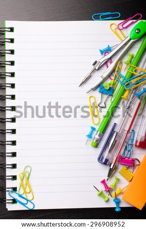 School education background with blank exercise book with copy space. Back to school concept. Top view. - stock photo