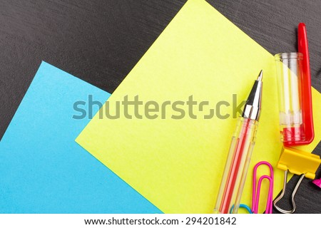 School education background with yellow and blue sticky notes, with copy space. Back to school concept. Top view. - stock photo