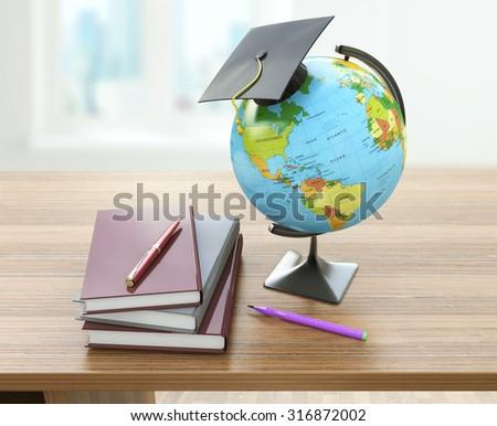 School education concept. Mortar board, textbooks, globe and pencils. Homeschooling concept - stock photo