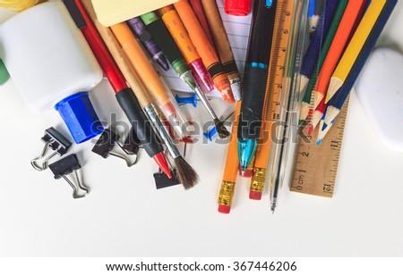 School equipment on white background - stock photo
