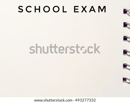 school exam written in bold black on white notepad