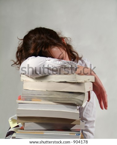 School Girl and a whole pile of her books - stock photo