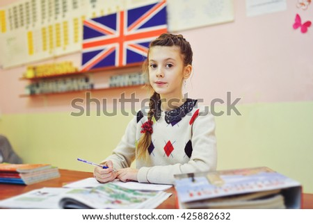 school girl in the class of english - stock photo