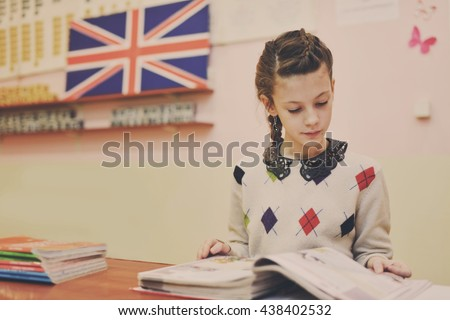 school girl in the class of english