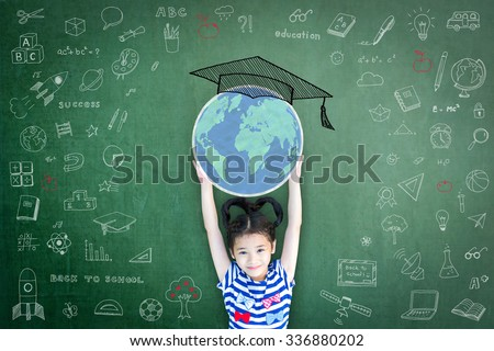 School girl kid raising world map globe freehand chalk doodle drawing of graduation cap hat on green chalkboard background celebrating educational success Children education and world literacy concept - stock photo