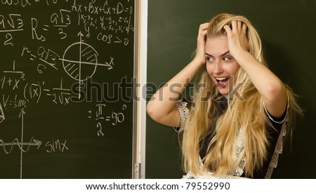 School girl on math classes finding solution - stock photo
