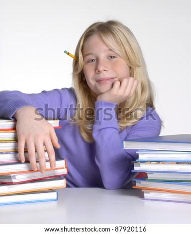 School girl portrait behind books. - stock photo
