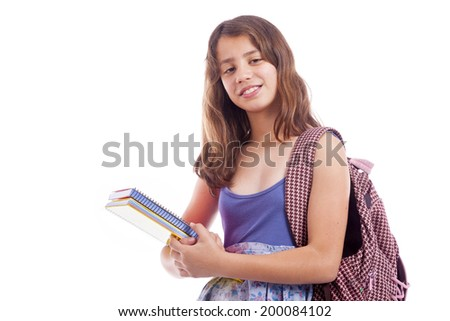 School girl standing with notebooks, isolated on white background