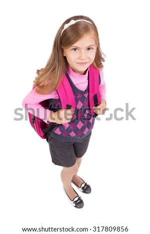 school girl with a backpack on a white background smiling, picture with depth of field and artistic blur - stock photo