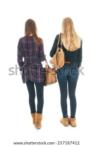school girls walking at school with heavy school bags