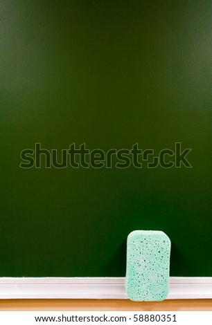 school green board with a light bath sponge - stock photo