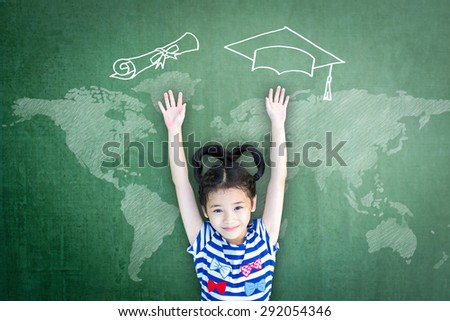 School kid raising hands up with freehand drawing of graduation cap, certificate roll and world map on green chalkboard wishing for educational success: Children education and world literacy concept