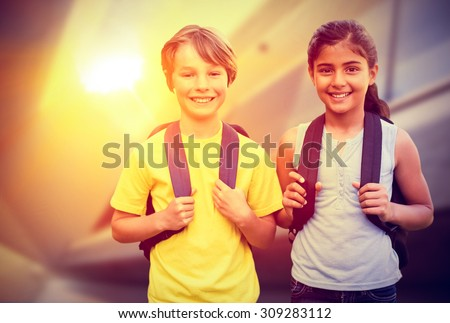 School kids against modern home with large windows - stock photo