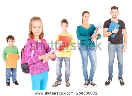 school levels progression with several students isolated in white - stock photo