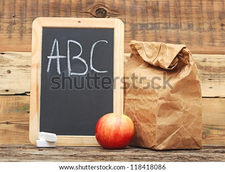 School lunch with black chalkboard ready for your text. - stock photo