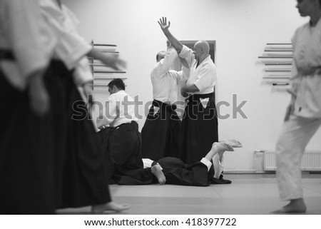School of martial arts; students training aikido technique - stock photo