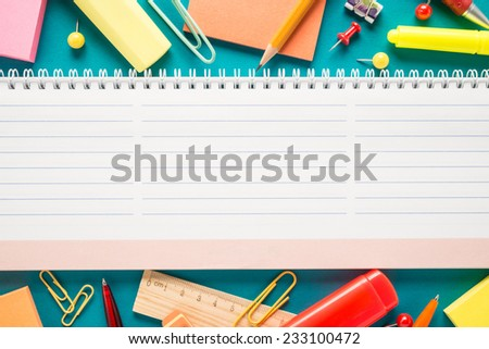 School office supplies on blue background  - stock photo
