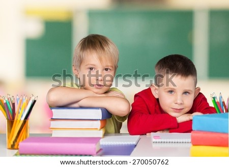 School. Portrait of cheerful school children flashing toothy smiles - stock photo