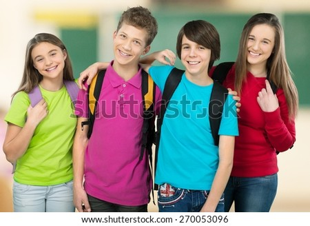 School. Portrait of smart schoolkids standing in line and looking at camera - stock photo