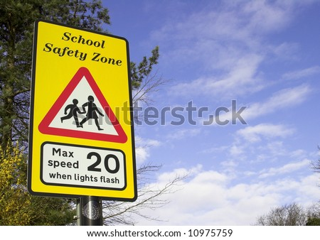 School Safety Zone Roadside Warning Sign - stock photo