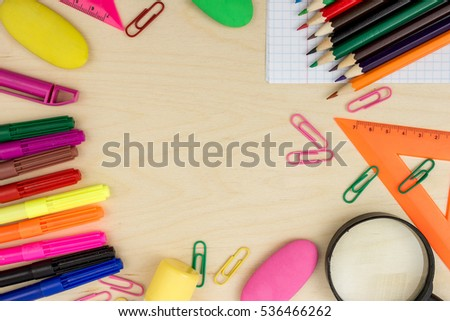 School stationery with notebook copyspace on wooden board