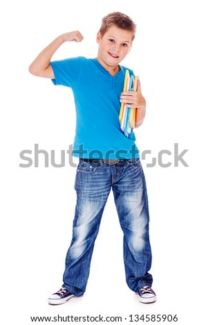 School student with books in hands demonstrating his strength - stock photo