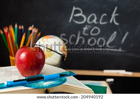 School supplies  and  blackboard. - stock photo