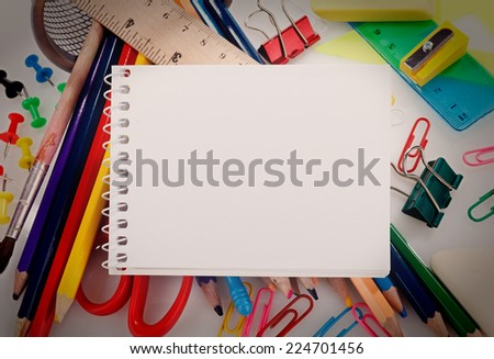 school supplies and notebook with blank sheet - stock photo