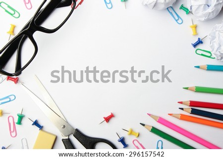 School supplies are on the white background. - stock photo