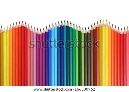School supplies colored pencils forming a wave, isolated on a white background - stock photo