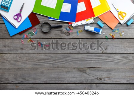School supplies on a wooden table with copy space, top view. Back to school - stock photo