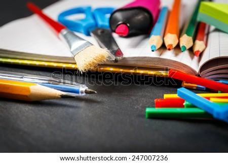 School supplies on black background - stock photo