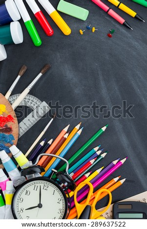 School supplies on the background of the teachers' board