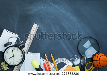 School supplies on the background of the teachers' board - stock photo