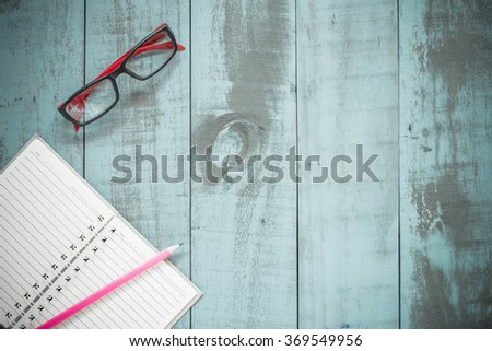 School supplies on Vintage old blue Wood Texture Background ready for your design. - stock photo