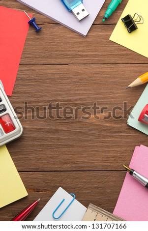 school supplies on wood background - stock photo