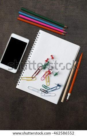 School supplies on wooden background, from above