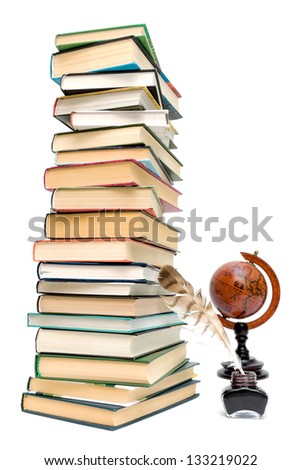 school supplies. pen in the ink, a large stack of books and a globe on a white background. - stock photo