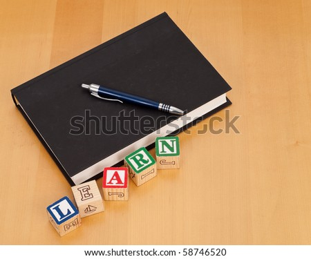 School Text Book with Letter Blocks - stock photo