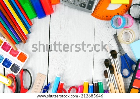 School tools. On a white, wooden background. - stock photo