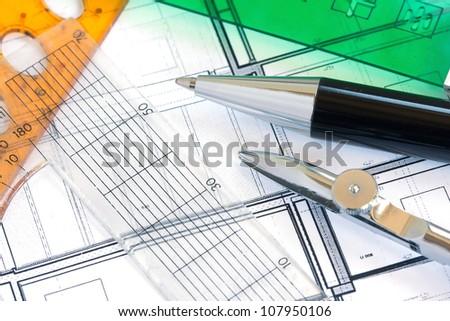 School utensils - rules, pens on design paper - stock photo