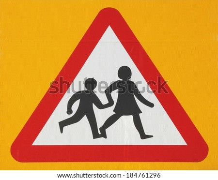 School warning road sign on a yellow background.  - stock photo