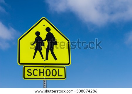 School Warning Sign with the sky background - stock photo