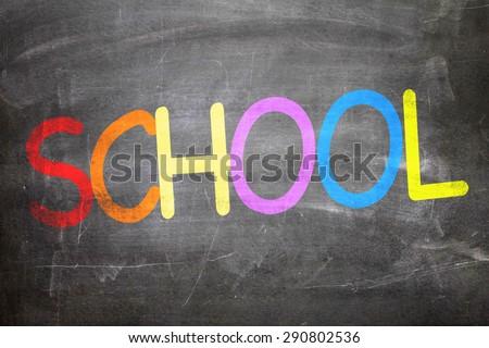 School written on a chalkboard - stock photo
